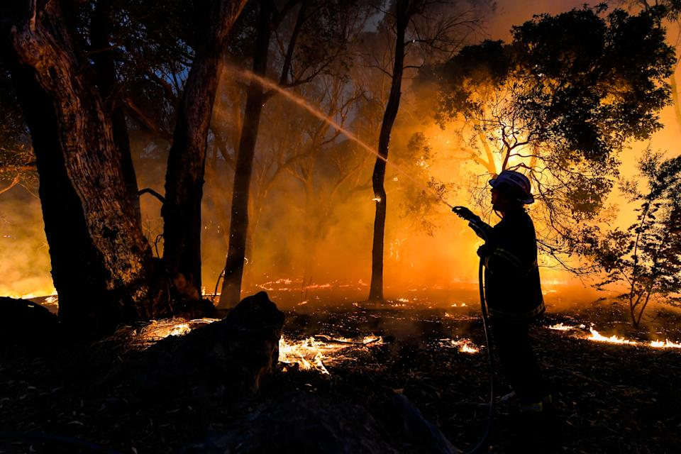 A firefighter works to extinguish a fire in December last year in Western Australia. Source: