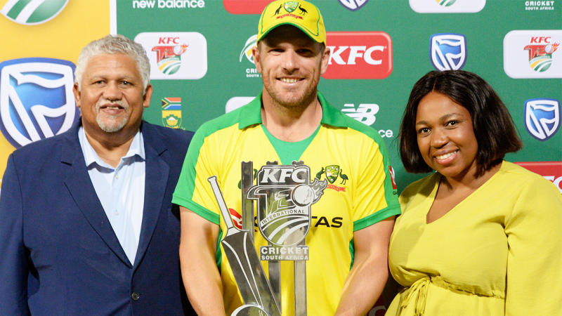 Aaron Finch smiles during the trophy presentation.