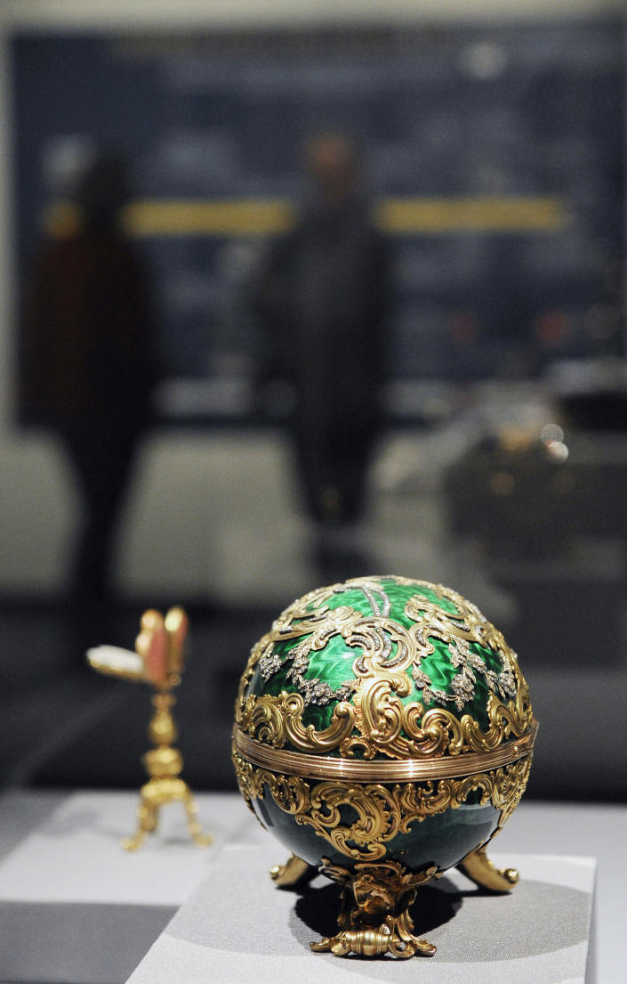 """The 1902 Kelch Rocaille Egg sits on display at the Houston Museum of Natural Science Tuesday, Feb. 19, 2013, in Houston as part of the largest private collection of items in the United States from the Russian artisan Peter Carl Faberge. The Kelch egg was created by Michael Perchin, one of Faberge's head workmasters. Featuring more than 350 objects, the exhibit """"Fabergé: A Brilliant Vision,"""" runs through Dec. 31, 2013 at the Houston Museum of Natural Science. (AP Photo/Pat Sullivan)"""