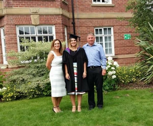 Gallagher's parents David and Karen (pictured together at her graduation before she became unwell) were unable to visit her in hospital. (Supplied: Brain Tumour Research)