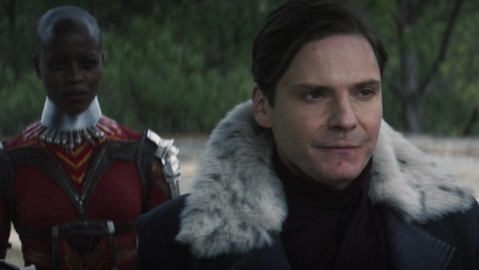 Ayo of the Dora Milaje stands behind Baron Zemo on The Falcon and the Winter Soldier