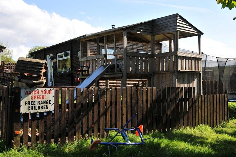 This family-friendly hut features a slide from its upper deck (Margaret Banford)