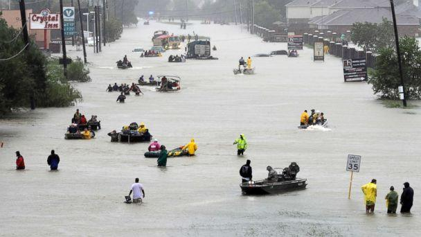 PHOTO: Rescue boats fill a flooded street at flood victims are evacuated as floodwaters from Harvey rise, Aug. 28, 2017, in Houston. (David J. Phillip/AP)