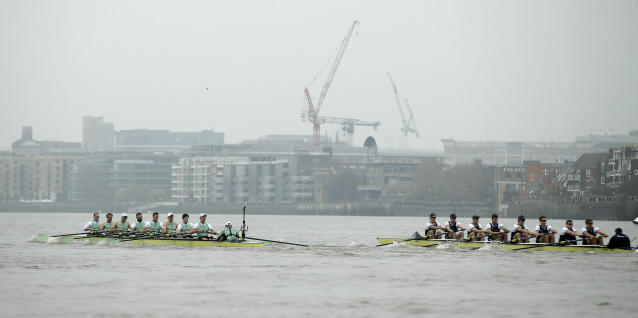 Cambridge, left, and Oxford boats during The Boat Race on the River Thames in London, Sunday April 7, 2019. The annual Boat Race traditionally fought out between Oxford and Cambridge university rowing crews. (Adam Davy/PA via AP)