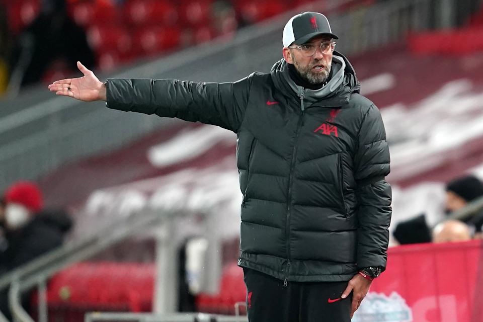 Jurgen Klopp and Liverpool sit atop the Premier League on goal difference, but they're also beset by injuries. (Photo by JON SUPER/POOL/AFP via Getty Images)
