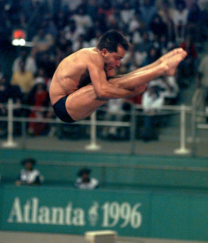 FILE - In this July 28, 1996 file photo, defending gold medalist Mark Lenzi of the United States competes in the preliminaries of the Olympic men's 3-meter springboard competition at Georgia Tech in Atlanta. Lenzi, the last American male diver to win Olympic gold, died Monday, April 9, 2012 at the age of 43 in Greenville, N.C. (AP Photo/Luca Bruno, File)