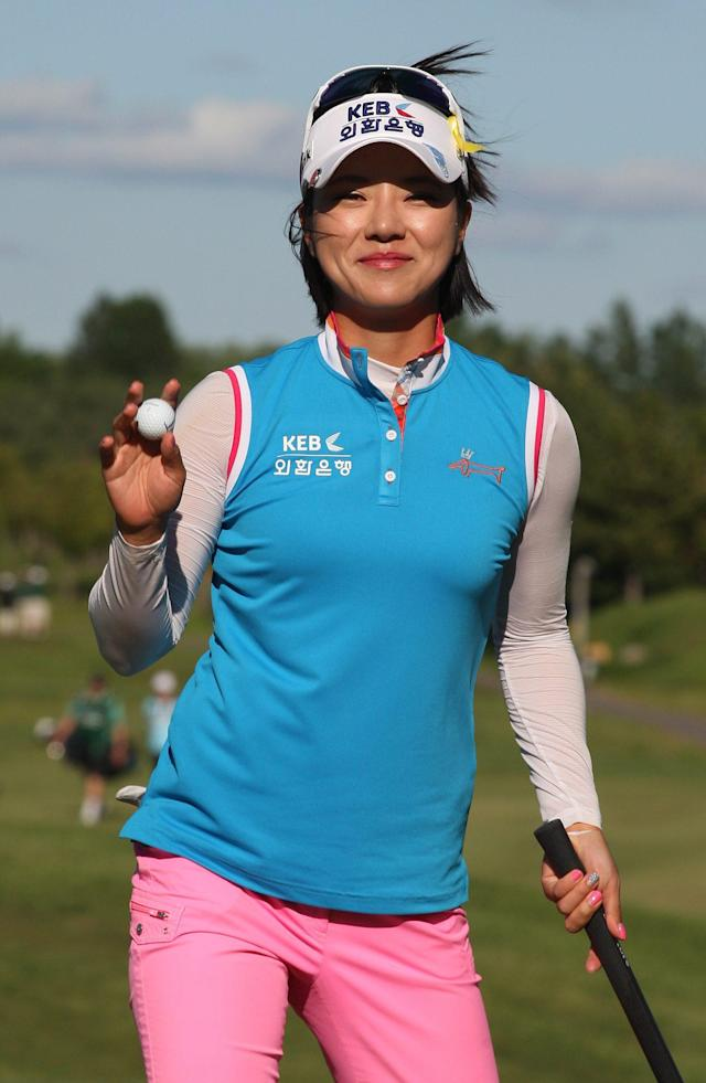 Defending champion Hee Young Park, of South Korea, acknowledges the galler after shooting a 6-under-par 65 for a share of the lead in the first round of the Manulife Financial Classic LPGA golf tournament Thursday, June 5, 2014, in Waterloo, Ontario. (AP Photo/The Canadian Press, Dave Chidley)
