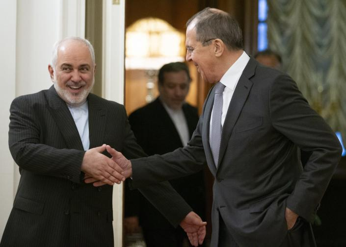 Russian Foreign Minister Sergey Lavrov, and Iranian Foreign Minister Mohammad Javad Zarif shake hands prior to their talks in Moscow, Russia, Monday, Dec. 30, 2019. (AP Photo/Alexander Zemlianichenko)