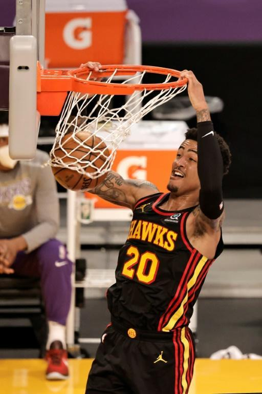 Atlanta's John Collins dunks in the Hawks' 99-94 NBA victory over the Los Angeles Lakers