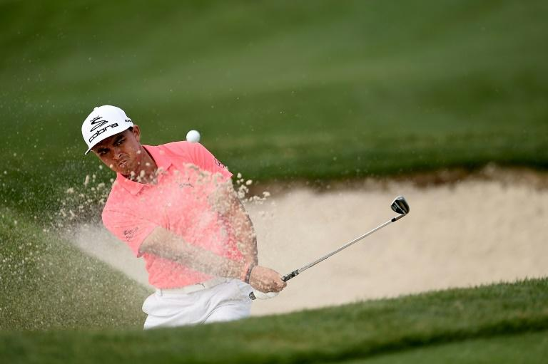 Rickie Fowler of the US hits his third shot from a greenside bunker on the 15th hole during the first round of the Shell Houston Open, in Humble, Texas, on March 30, 2017