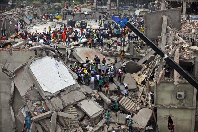 Bangladeshi rescuers work at the site of a building that collapsed Wednesday in Savar, near Dhaka, Bangladesh, Thursday, April 25, 2013. By Thursday, the death toll reached at least 194 people as rescuers continued to search for injured and missing, after a huge section of an eight-story building that housed several garment factories splintered into a pile of concrete.(AP Photo/A.M. Ahad)