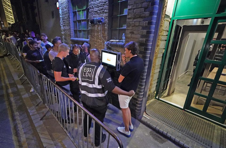 People have their ID checked as they queue up for the Egg nightclub in London (PA Wire)