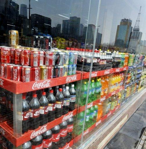 Bottles of Coca-Cola are displayed on the shelves of a store in Beijing. China has experienced several scares over food safety in recent years, many blamed on lax supervision or producers deliberately cutting corners and deceiving consumers in search of profits