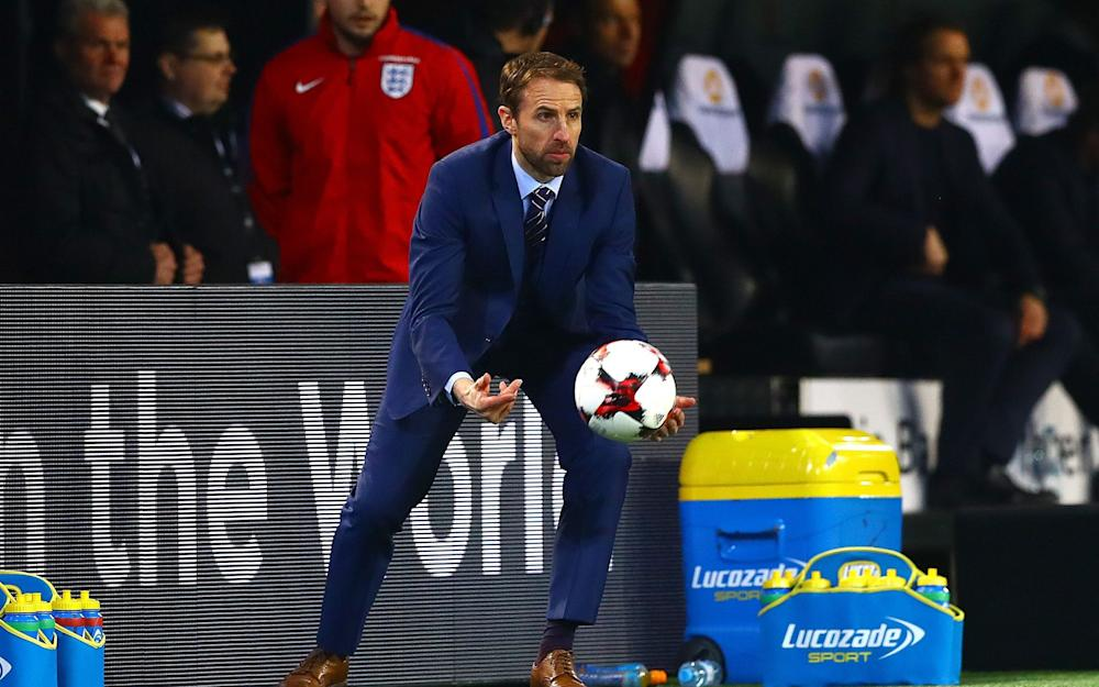 England manager Gareth Southgate throws the ball during the International Friendly match - Credit: Rex