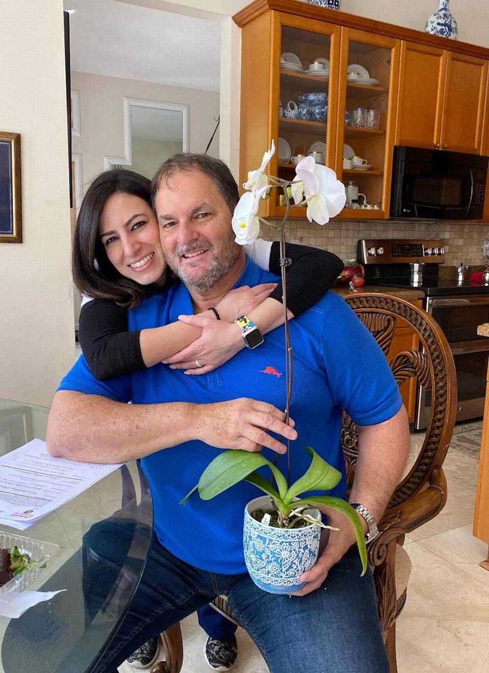 Dr. Carlos Vallejo, an internist in South Florida, poses with his daughter Gisselle Vallejo. Carlos Vallejo died from complications stemming from COVID-19 on Aug. 1, 2020.