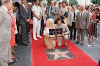 <p>Dolly received her first of two stars on the Hollywood Walk of Fame (!) in 1987 alongside <em>Rhinestone</em> co-star Sylvester Stallone.</p>