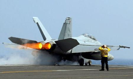 FILE PHOTO: A U.S. Navy F18 fighter jet takes off from aircraft carrier USS Carl Vinson during a routine exercise in South China Sea