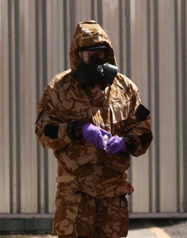 An investigator in a chemical suit works in Salisbury, following the second poisonings