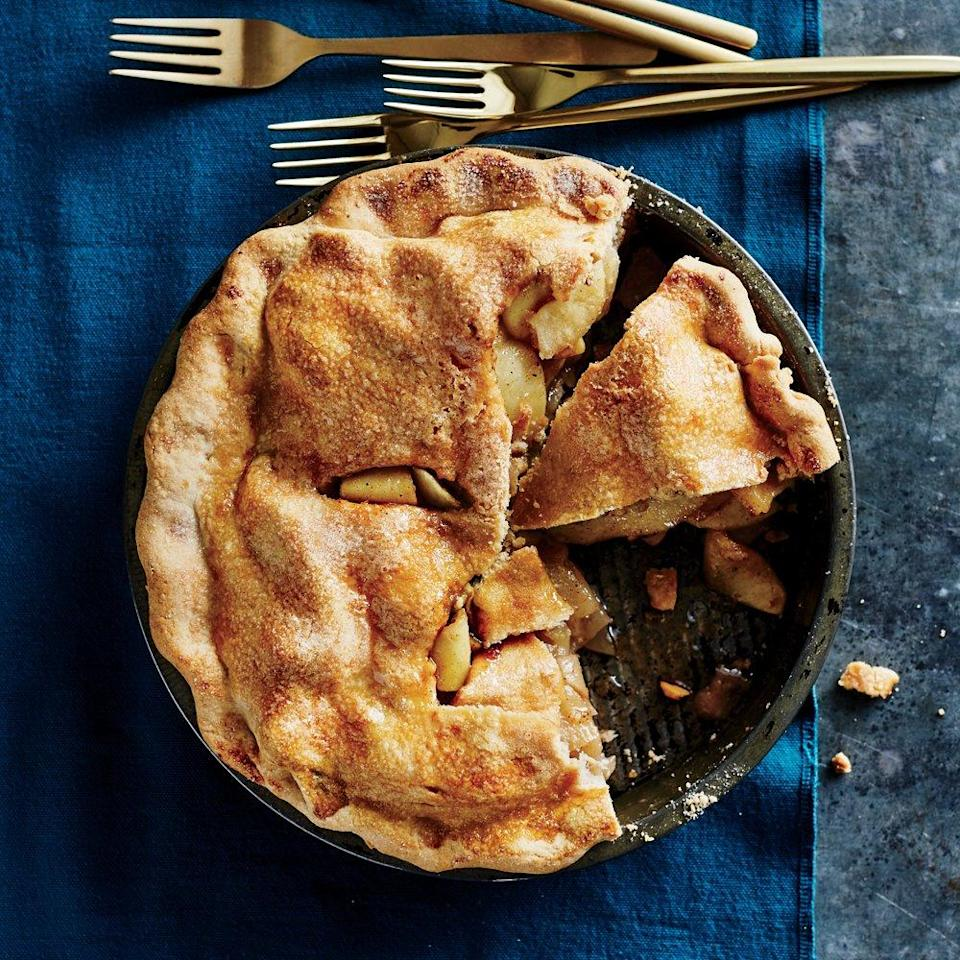 """<p>A double crust seals in the apples' natural juices as the pie bakes for full-on apple flavor. Tossing the apples with apple juice keeps them from browning as you peel and slice them, and it adds a boost of apple flavor.</p> <p><a href=""""https://www.myrecipes.com/recipe/double-crust-apple-pie-0"""" rel=""""nofollow noopener"""" target=""""_blank"""" data-ylk=""""slk:Double-Crust Apple Pie Recipe"""" class=""""link rapid-noclick-resp"""">Double-Crust Apple Pie Recipe</a></p>"""