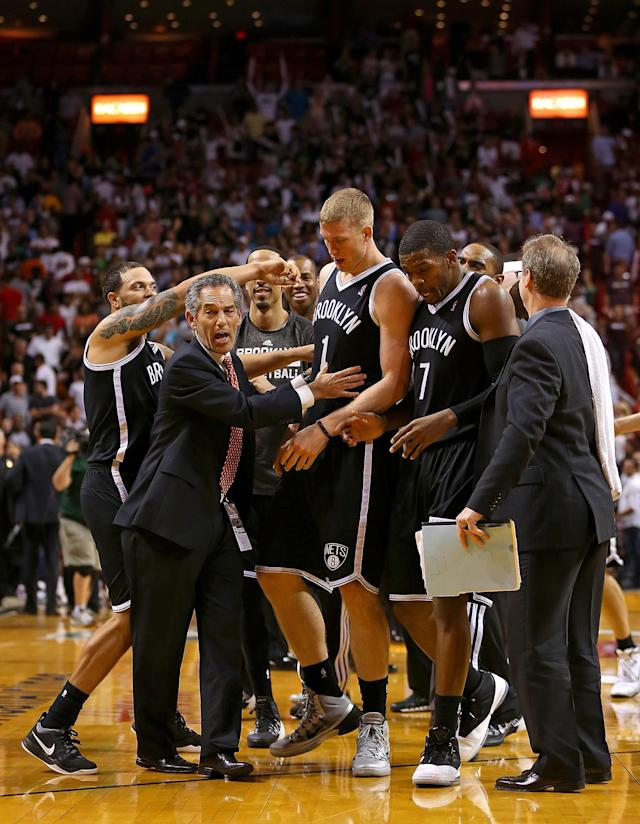 MIAMI, FL - APRIL 08: Mason Plumlee #1 of the Brooklyn Nets is congratulated by teammates after blocking the final shot during a game against the Miami Heat at AmericanAirlines Arena on April 8, 2014 in Miami, Florida. (Photo by Mike Ehrmann/Getty Images)