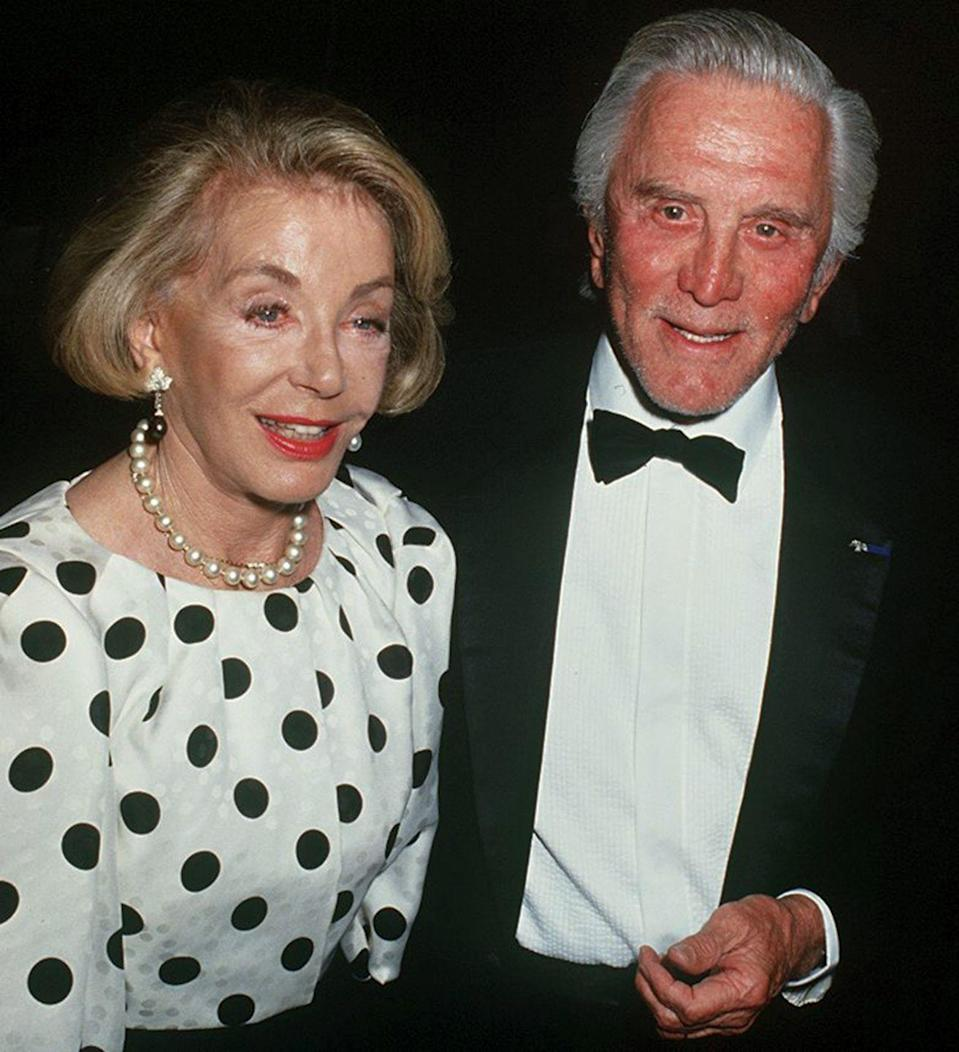 <p>Douglas and Buydens attending a formal event. The married couple met when Buydens applied to be his assistant for his film <em>Act of Love.</em> She initially turned his dinner invitations down. </p>