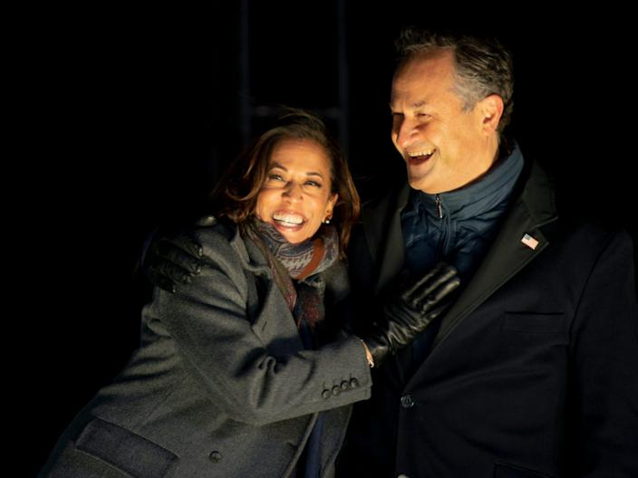 PHILADELPHIA, PA - NOVEMBER 02: Democratic vice presidential nominee Sen. Kamala Harris (D-CA) and husband, Douglas Emhoff, embrace on stage after Democratic presidential nominee Joe Biden spoke in Pittsburgh at a simultaneous drive-in election eve rally on November 2, 2020 in Philadelphia, Pennsylvania. Democratic presidential nominee Joe Biden, who is originally from Scranton, Pennsylvania, remains ahead of President Donald Trump by about six points, according to a recent polling average. With the election tomorrow, Trump held four rallies across Pennsylvania over the weekend, as he vies to recapture the Keystone State's vital 20 electoral votes. In 2016, he carried Pennsylvania by only 44,292 votes out of more than 6 million cast, less than a 1 percent differential, becoming the first Republican to claim victory here since 1988. (Photo by Mark Makela/Getty Images)