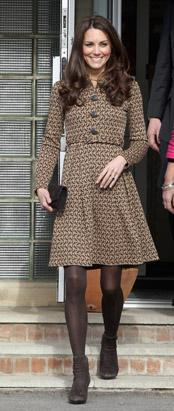 Catherine, Duchess of Cambridge, meets children as she leaves Rose Hill Primary School during a visit Feb. 21, 2012, to Oxford wearing a dove-patterned dresscoat designed by Orla Kiely