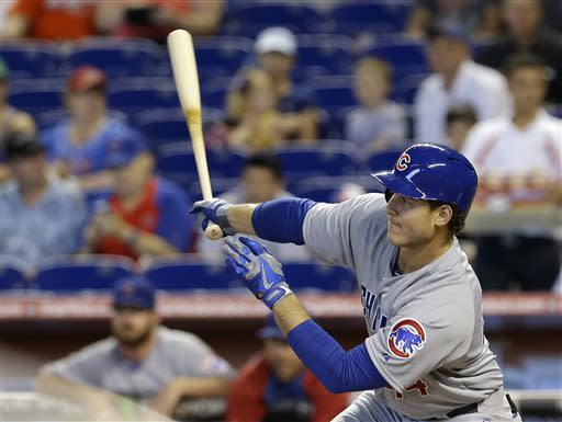 Chicago Cubs' Anthony Rizzo follows through on a double against the Miami Marlins in the first inning of a baseball game in Miami, Sunday, April 28, 2013. Cubs' Alfonso Soriano scored on the double. (AP Photo/Alan Diaz)