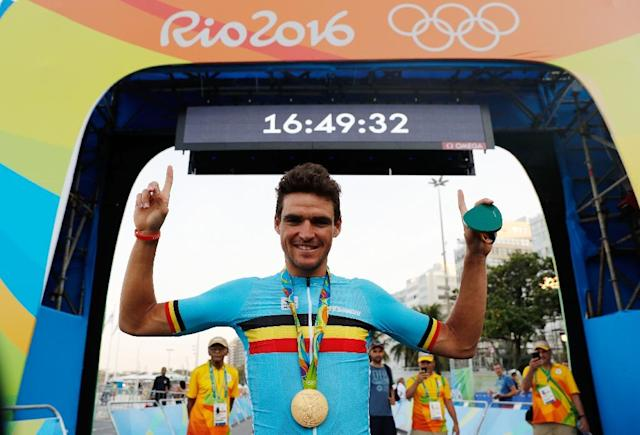 Belgium's Greg Van Avermaet poses with his gold medal after winning the men's road cycling race in Rio de Janeiro on August 6, 2016 (AFP Photo/Adrian Dennis)