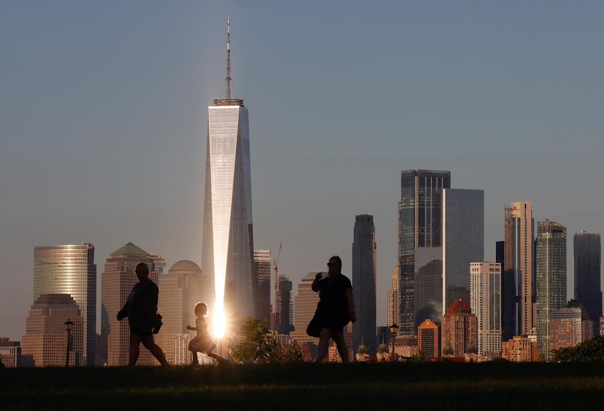 JERSEY CITY, NJ - SEPTEMBER 7: The setting sun reflects off the windows of One World Trade Center in New York City on September 7, 2021 as seen from Jersey City, New Jersey. (Photo by Gary Hershorn/Getty Images)