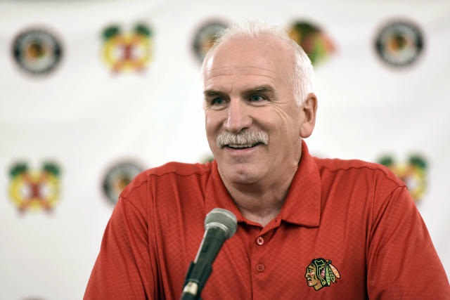 FILE - In this July 21, 2017 file photo, Chicago Blackhawks' head coach Joel Quenneville speaks at a news conference during the NHL hockey team's convention in Chicago. The Blackhawks have fired the three-time Stanley Cup winning coach. General manager Stan Bowman announced the startling dismissal of Quenneville and assistants Kevin Dineen and Ulf Samuelsson on Tuesday, Nov. 6, 2018, and appointed Jeremy Colliton the new coach. Chicago was off to a 6-6-3 start and missed the playoffs last season. (AP Photo/G-Jun Yam, File)