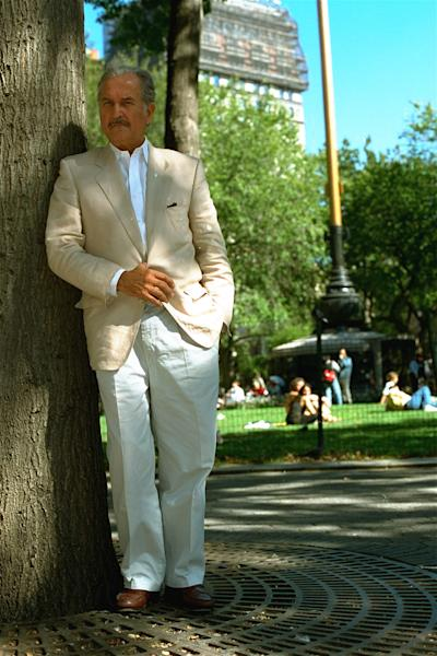 FILE.- In this Oct. 1995 file photo, Mexican novelist Carlos Fuentes poses for a photograph near Union Square in New York City ( NY). Whatever they may have thought of his politics, anyone lucky enough to have conversed with Carlos Fuentes couldn't help but be taken by his patrician good looks and his love affair with language. Fuentes died in Mexico City Tuesday at the age of 83.(AP Photo/Rick Maiman, File )