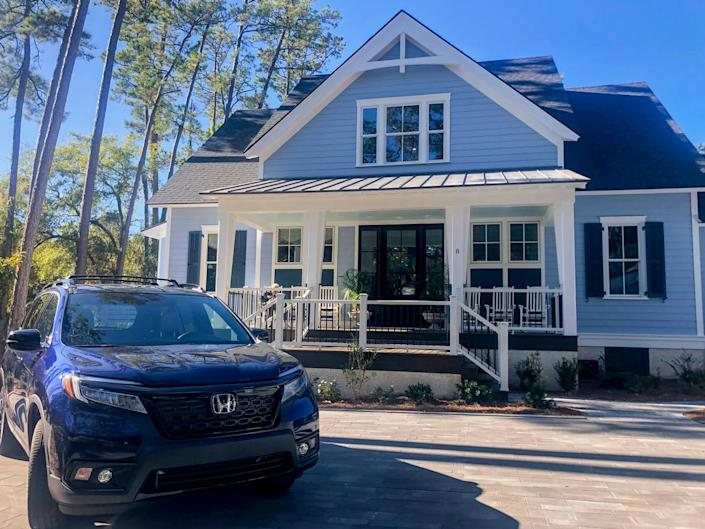 The HGTV 2020 Dream Home in Windmill Harbour on Hilton Head Island, with a Honda Passport Elite parked in its driveway. The winner of the giveaway will win both the car and home.