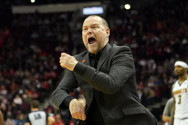 Denver Nuggets' coach Michael Malone looks for a traveling call during the second half of an NBA basketball game against the Houston Rockets Wednesday, Jan. 22, 2020, in Houston. The Rockets won 121-105. (AP Photo/David J. Phillip)