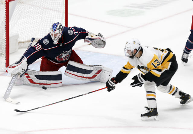 Columbus Blue Jackets goalie Joonas Korpisalo, left, of Finland, stops a shot by Pittsburgh Penguins forward Brandon Tanev during the third period of an NHL hockey game in Columbus, Ohio, Friday, Nov. 29, 2019. (AP Photo/Paul Vernon)
