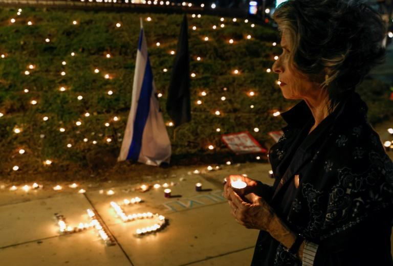 In Tel Aviv's Habima square on Saturday evening, people lit candles at a small vigil to honour the victims