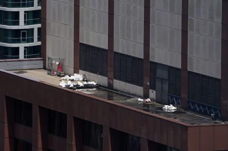 Debris is pictured on 787 7th Ave a day after a helicopter crashed into the building in New York City