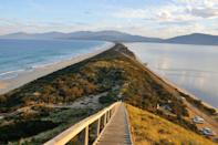 """<p>This island-state seated just below Australia is wild, rustic, and geographically diverse, as nearly 40 percent of the island is protected for national parks and national heritage wilderness. White sand beaches with sweeping ocean and mountain views are a hallmark of Tasmania, making it an ultimate destination for island getaways.</p><p>Those with a penchant for history, art, and design will fall in love with <a href=""""https://www.islingtonhotel.com/"""" rel=""""nofollow noopener"""" target=""""_blank"""" data-ylk=""""slk:Islington Hotel"""" class=""""link rapid-noclick-resp"""">Islington Hotel</a> in Hobart which offers a haute, enlightening experience in Tasmania. </p>"""