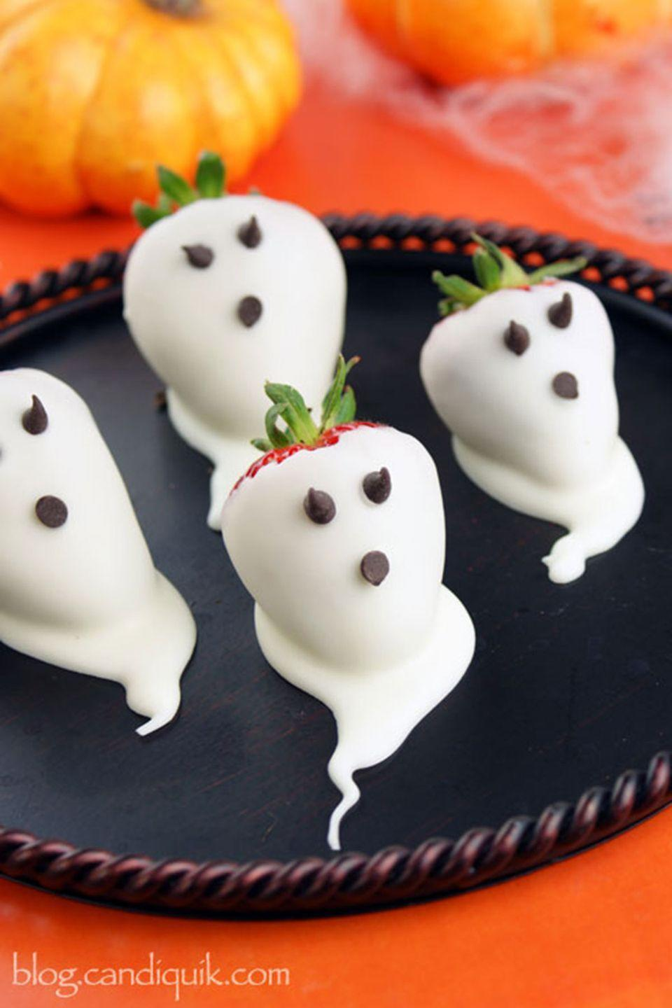 """<p>Kids and adults alike will love these adorable little treats. Fool them all into snacking on fresh fruit (covered in white chocolate) all night long.</p><p><strong>Get the recipe at <a href=""""http://blog.candiquik.com/strawberry-ghosts/"""" rel=""""nofollow noopener"""" target=""""_blank"""" data-ylk=""""slk:Miss Candiquik"""" class=""""link rapid-noclick-resp"""">Miss Candiquik</a>. </strong> </p>"""