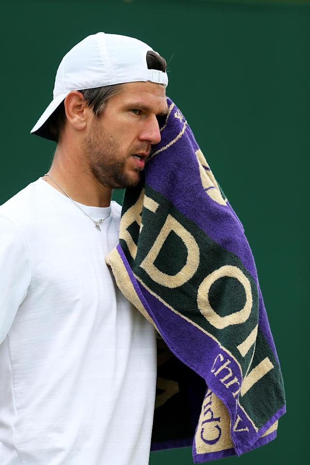 LONDON, ENGLAND - JULY 01: Jurgen Melzer of Austria reacts during the Gentlemen's Singles fourth round match against Jerzy Janowicz of Poland on day seven of the Wimbledon Lawn Tennis Championships at the All England Lawn Tennis and Croquet Club on July 1, 2013 in London, England. (Photo by Julian Finney/Getty Images)