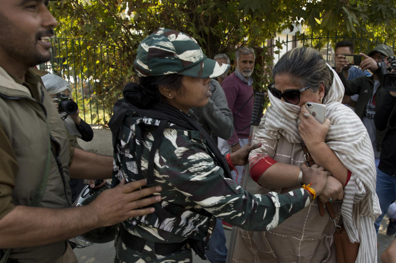 Indian paramilitary women detain a Kashmiri woman who was among those protesting against Indian government downgrading the region's semi-autonomy in Srinagar, Indian controlled Kashmir, Tuesday, Oct. 15, 2019. A small group of women under the banner of 'Women of Kashmir', a civil society group had gathered for a peaceful protest demanding restoration of civil liberties and fundamental rights of citizens. (AP Photo/Dar Yasin)