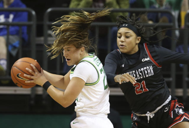 Oregon's Sabrina Ionescu, left, pulls down a rebound ahead of Northeastern's Samantha Michel during the third quarter of an NCAA college basketball game in Eugene, Ore., Monday, Nov. 11, 2019. (AP Photo/Chris Pietsch)