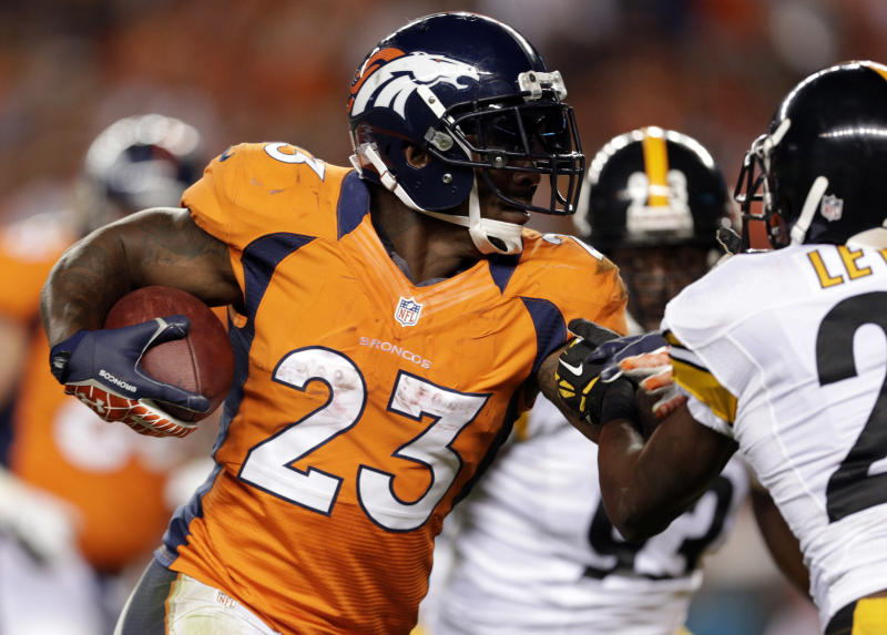 FILE - In this Sept. 9, 2012, Denver Broncos running back Willis McGahee runs against the Pittsburgh Steelers during the fourth quarter of an NFL football game in Denver. As training camps open, veterans like John Abraham, Dallas Clark, Richard Seymour and McGahee are unemployed. (AP Photo/Joe Mahoney, File)