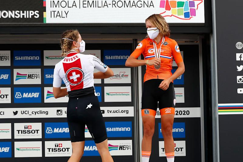 IMOLA ITALY SEPTEMBER 24 Pdium Marlen Reusser of Switzerland Silver medal Ellen Van Dijk of The Netherlands Bronze medal Celebration Social distance Mask Covid safety measures during the 93rd UCI Road World Championships 2020 Women Elite Individual Time Trial a 317km stage from Imola to Imola ITT ImolaEr2020 Imola2020 on September 24 2020 in Imola Italy Photo by Bas CzerwinskiGetty Images