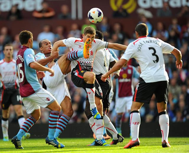 BIRMINGHAM, ENGLAND - AUGUST 24: Liverpool captain Steven Gerrard (c) is challenged by Villa player Gabriel Agbonlahor (2nd left) during the Barclays Premier League match between Aston Villa and Liverpool at Villa Park on August 24, 2013 in Birmingham, England. (Photo by Stu Forster/Getty Images)