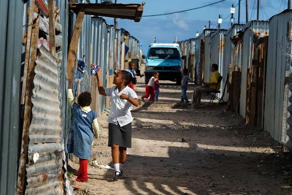Shack fires are a perennial threat to the impoverished residents of sprawling informal settlements such as Blikkiesdorp, pictured here on April 20, 2010 about 25km East of Cape Town (AFP Photo/Rodger Bosch)