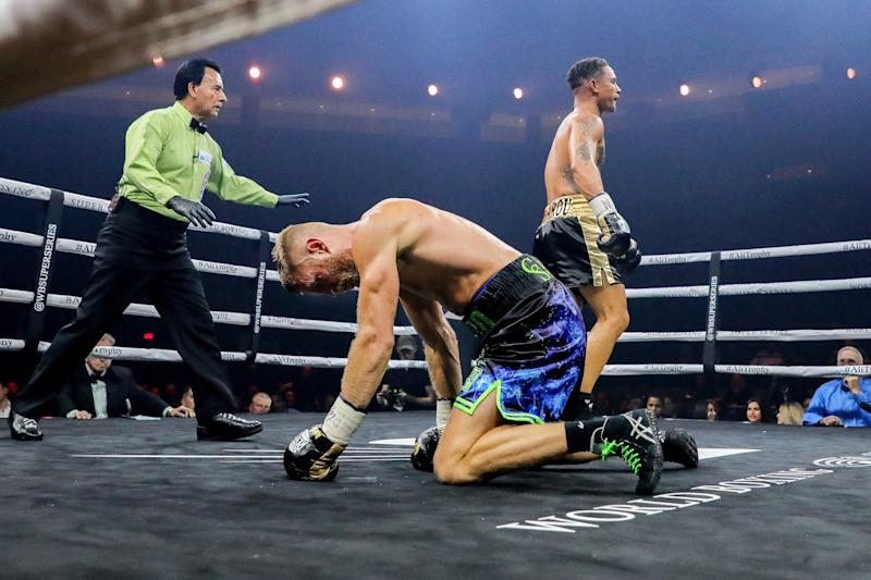 Oct 27, 2018; New Orleans, LA, USA; Regis Prograis knocks down Terry Flanagan during the quarter final bout of the World Boxing Super Series at UNO Lakefront Arena. Mandatory Credit: Stephen Lew-USA TODAY Sports/Sipa USA