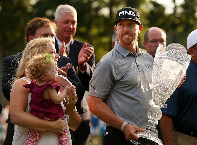 Hunter Mahan celebrates with his wife Kandi, daughter Zoe and the tournament trophy after winning of The Barclays at The Ridgewood Country Club on August 24, 2014 in Paramus, New Jersey (AFP Photo/Darren Carroll)