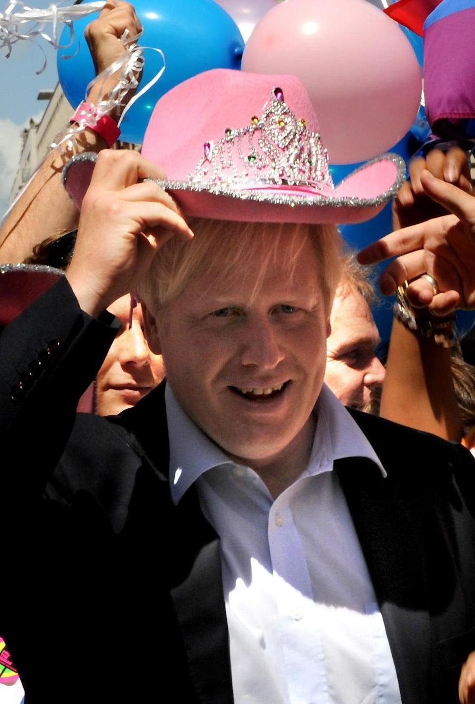 Boris Johnson wears a pink cowboy hat at the Pride London parade (Anthony Delvin/PA) (PA Archive)