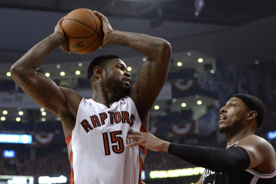 Amir Johnson, left. (AP)